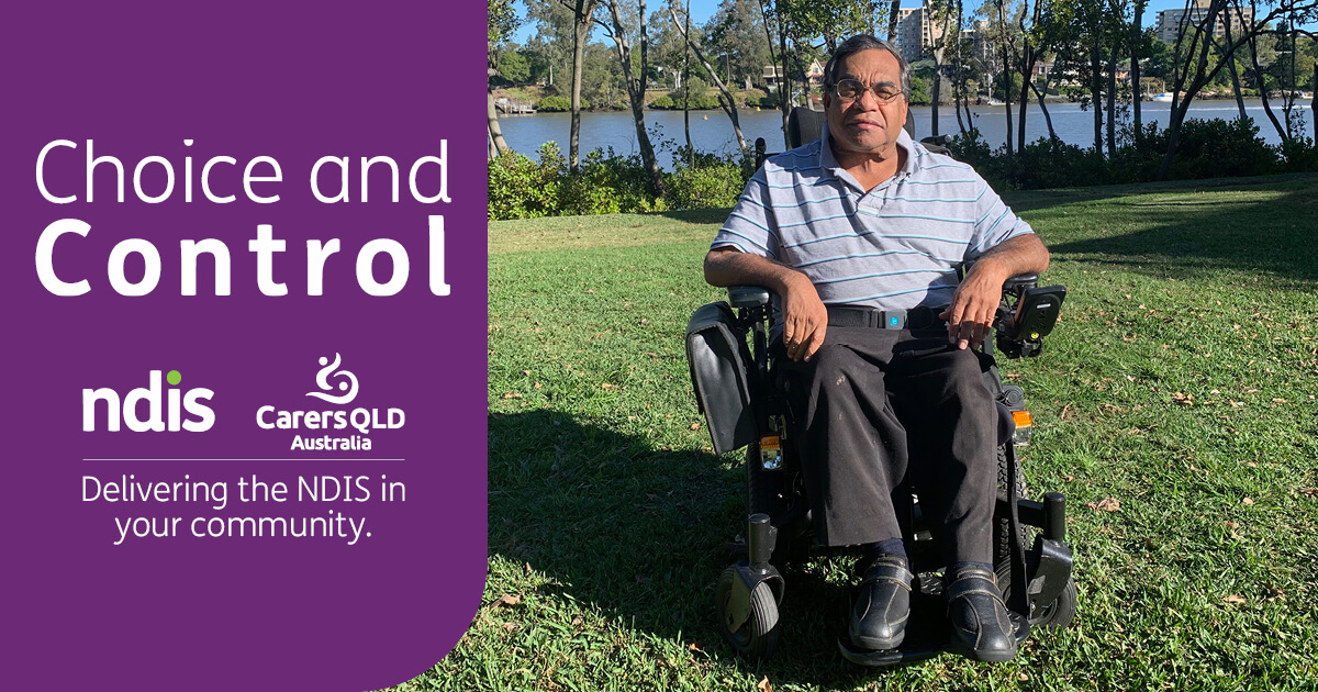 Uncle Willie Prince in a park by a river. He is sitting in a wheelchair.